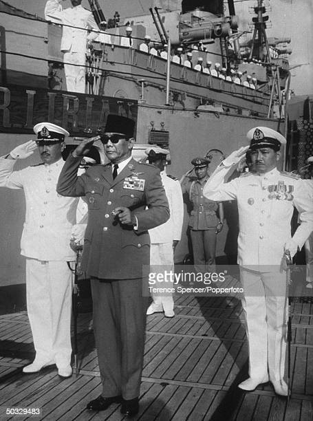 Sukarno saluting from the deck of the cruiser Irian bought by fr the Russians