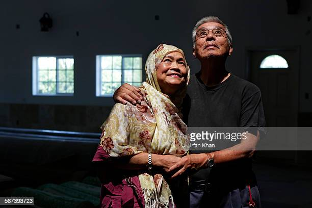 JULY 04 2014 Sukathee Phyakul left and husband Rahmat Phyakul on Friday July 04 2014 stand under the shaft of light from a skylight installed in...