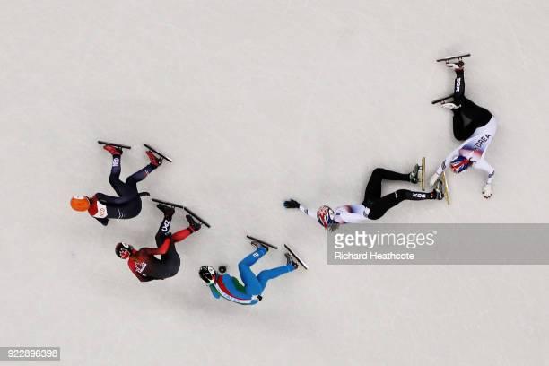 Sukhee Shim of Korea and Minjeong Choi of Korea crash during the Ladies' 1000m Short Track Speed Skating Final A on day thirteen of the PyeongChang...