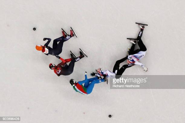 Sukhee Shim of Korea and Minjeong Choi of Korea crash during the Ladies' 1000m Short Track Speed Skating Final A on day thirteen of the PyeongChang...