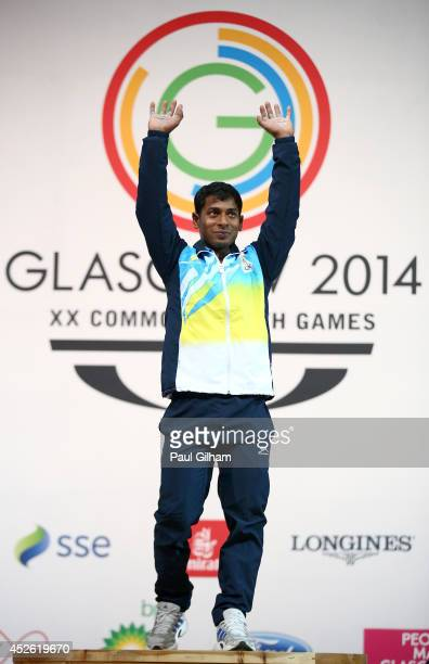 Sukhen Dey of India celebrates winning the Gold Medal in the Men's 56kg Weightlifting at the Scottish Exhibition And Conference Centre during day one...