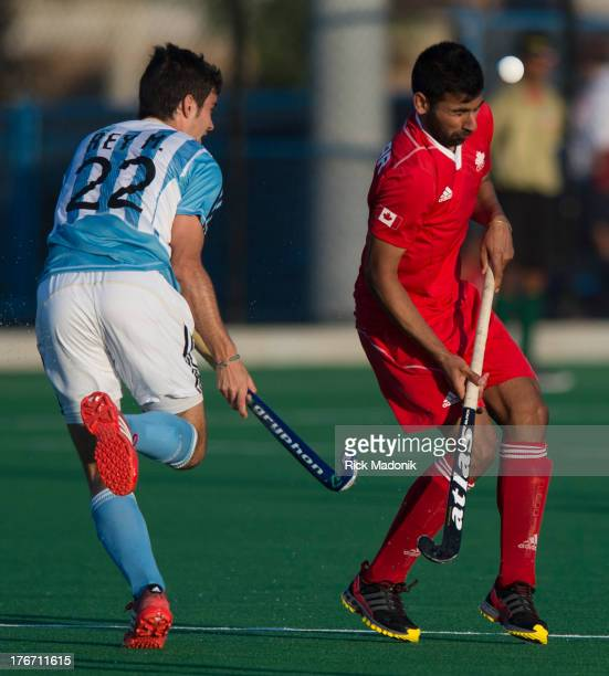 Sukhi Panesar winces after the ball hits him as Argentina's Matias Rey stays close. Mens Pan American Cup final between Canada and Argentina, in...
