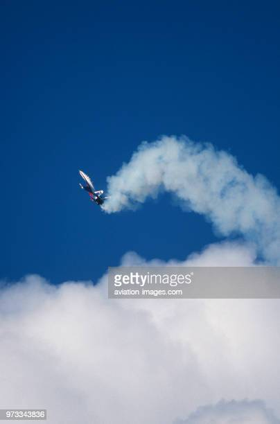 Sukhoi Su27 Flanker in the flyingdisplay at the 1994 Farnborough Airshow performing the Cobra manoeuvre above clouds with white smoke