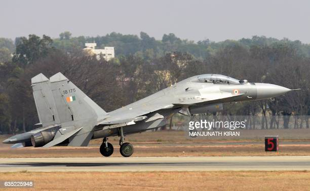 A Sukhoi Su30MKI combat aircraft of the Indian Air Force takes off during an aerial display at Yelahanka Air Force Station on the inaugural day of...