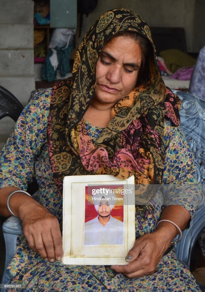 Sukhwinder Kaur grieving the death of her son Manjinder Singh who was killed in Iraq at Bhoewal Village on March 20 2018 near Amritsar India The 39...
