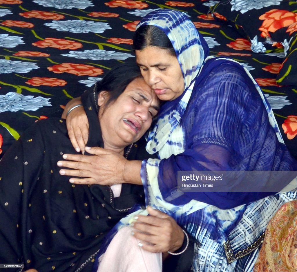 Sukhwinder Kaur mother of Manjinder Singh one of the workers killed in Iraq`s Mosul grieving the death of her son at his residence in Bhoewal Village.