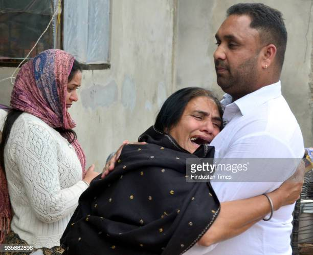 Sukhwinder Kaur mother of Manjinder Singh one of the workers killed in Iraqs Mosul grieving the death of his son at his residence in Bhoewal Village...