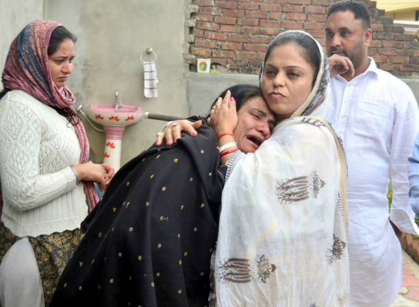 Sukhwinder Kaur mother of Manjinder Singh one of the workers killed in Iraq`s Mosul showing her sorrow when Punjab State Women`s Commission...
