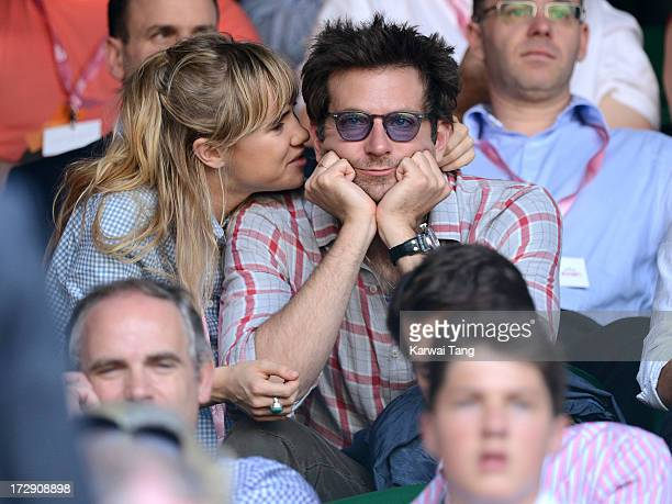 Suki Waterhouse and Bradley Cooper attend the Jerzy Janowicz vs Andy Murray match on Day 11 of the Wimbledon Lawn Tennis Championships at the All...