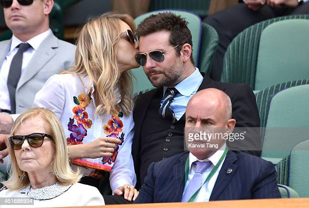 Suki Waterhouse and Bradley Cooper attend the semifinal match between Noval Djokovic and Grigor Dimitrov on centre court at The Wimbledon...