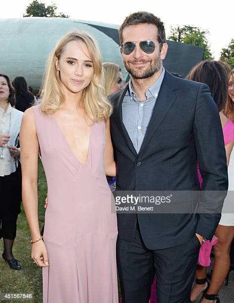 Suki Waterhouse and Bradley Cooper attend The Serpentine Gallery Summer Party cohosted by Brioni at The Serpentine Gallery on July 1 2014 in London...