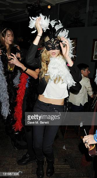 Suki Waterhouse and Cara Delevingne attend the Alice Olivia Black Tie Carnival hosted by designer Stacey Bendet at Paradise by Way of Kensal Green on...