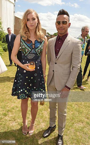 Suki Waterhouse and Lewis Hamilton depart the Burberry Menswear Spring/Summer 2016 show at Kensington Gardens on June 15, 2015 in London, England.