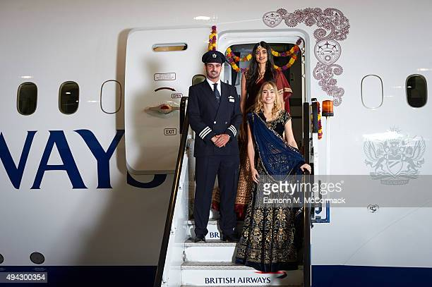 Suki Waterhouse and Neelam Gill pose with Pilot Suneil Banerjee during a photo shoot to mark the launch of flights by the new British AirwaysBoeing...
