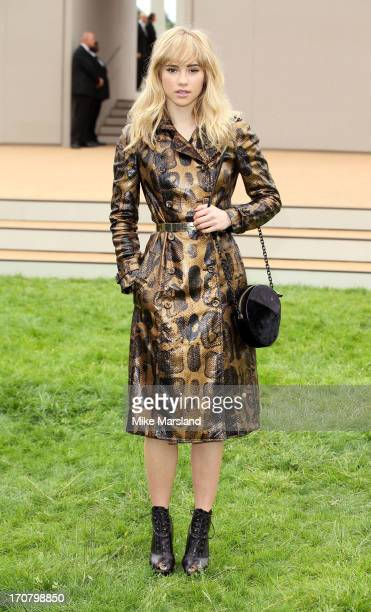 Suki Waterhouse arrives for the Burberry Prorsum show at the London Collections: MEN SS14 at Kensington Gardens on June 18, 2013 in London, England.