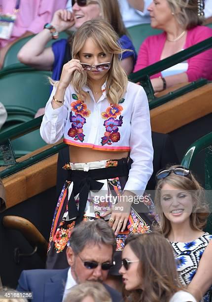 Suki Waterhouse attends the semifinal match between Noval Djokovic and Grigor Dimitrov on centre court at The Wimbledon Championships at Wimbledon on...