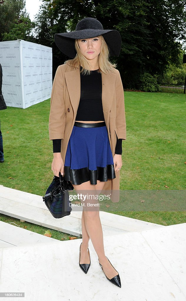Suki Waterhouse attends the Unique SS14 show during London Fashion Week on September 15, 2013 in London, England.