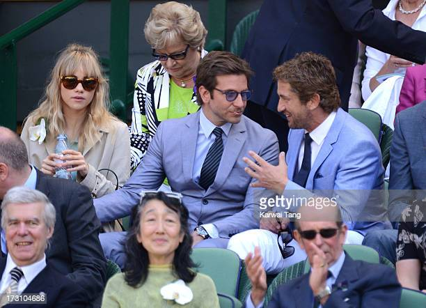 Suki Waterhouse, Bradley Cooper and Gerard Butler attend the Men's Singles Final between Novak Djokovic and Andy Murray on Day 13 of the Wimbledon...