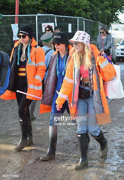 Suki Waterhouse Cara Delevingne and Clara Paget attend day 1 of Glastonbury Festival on June 24 2016 in Glastonbury England