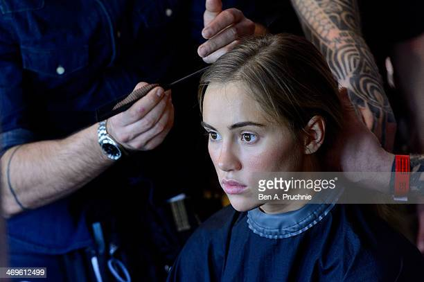 Suki Waterhouse gets prepared backstage at the Hunter Original show at London Fashion Week AW14 at University of Westminster on February 15 2014 in...