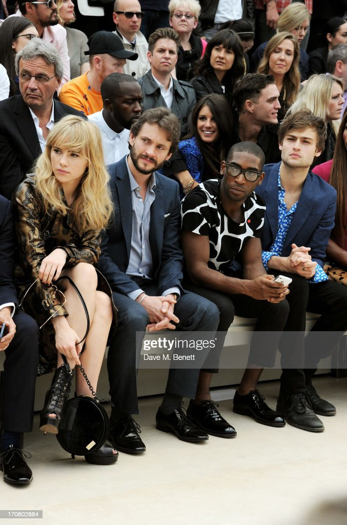 Suki Waterhouse, Hugh Dancy, Tinie Tempah and Douglas Booth sit in the front row at Burberry Menswear Spring/Summer 2014 at Kensington Gardens on June 18, 2013 in London, England.