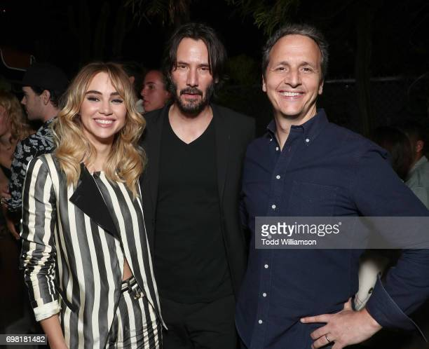Suki Waterhouse Keanu Reeves and Neon's Tom Quinn attend the after party for the premiere of Neon's 'The Bad Batch' on June 19 2017 in Los Angeles...