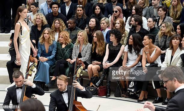 Suki Waterhouse Sienna Miller Kate Moss Cara Delevingne Annie Clark Naomie Harris guest Sophie Hunter and Benedict Cumberbatch attend the Burberry...