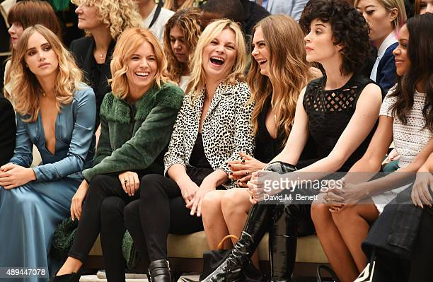Suki Waterhouse Sienna Miller Kate Moss Cara Delevingne Annie Clark and Naomie Harris attend the Burberry Womenswear Spring/Summer 2016 show during...