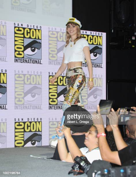 Suki Waterhouse walks onstage during the 'Assassination Nation' panel with the cast and the Russo Brothers during ComicCon International 2018 at San...