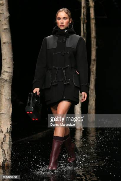 Suki Waterhouse walks the runway at the Hunter Original show at London Fashion Week AW14 at University of Westminster on February 15 2014 in London...