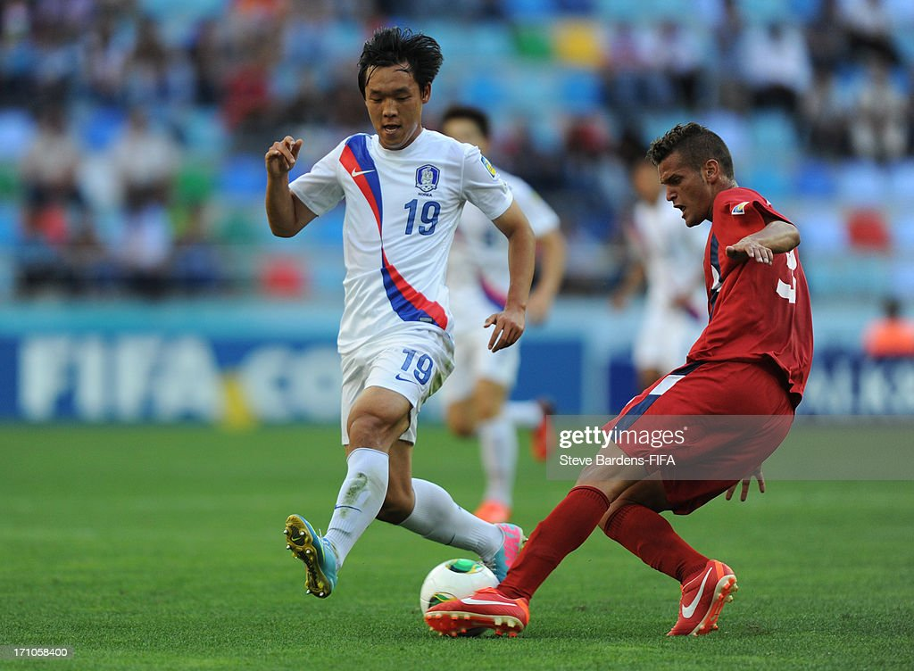 Sukjae Cho of Korea Republic is tackled by Lazaro Mezquia of Cuba during the FIFA U-20 World Cup Group B match between Cuba and Korea Republic at Kadir Has Stadium on June 21, 2013 in Kayseri, Turkey.