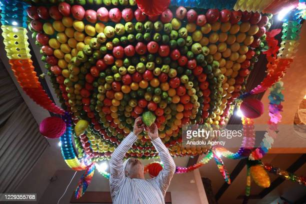 Sukkah, is made of fruits inside a Samaritan's house ahead of the Sukkot Holiday as the preparations continue amid the coronavirus pandemic, in...