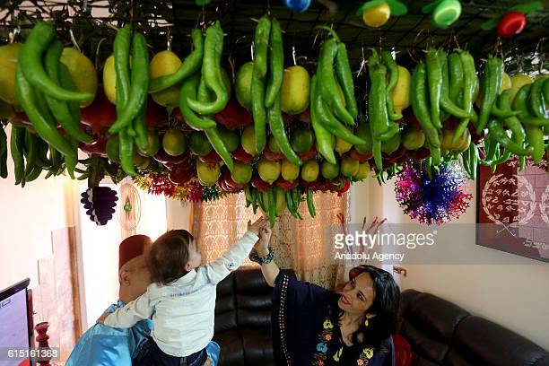 Sukkah, made of fruits inside a Samaritan's house is seen during the Sukkot Holiday in Nablus, West Bank, on October 17, 2015. It is a biblical...