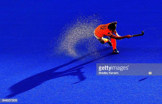 Sukri Mutalib of Malaysia strikes the ball in the match between Malaysia and Scotland during Hockey on day nine of the Gold Coast 2018 Commonwealth...