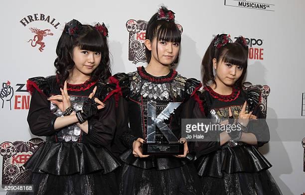Sukuka Nakamoto 'SuMetal' Yui Mizuno as 'Yuimetal' and Moa Kikuchi as 'Moametal' of Baby Metal win Award for Best Band at the Kerrang Awards 2016 at...