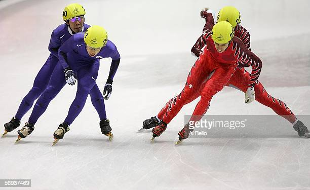 SukWoo Song and HoSuk Lee both of Korea and Eric Bedard and Charles Hamelin both of Canada skate on the final day of the men's 5000 meter relay in...