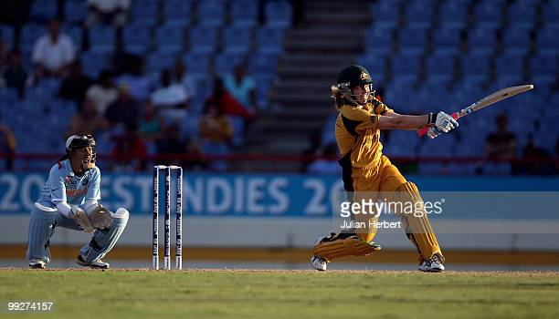 Sulakshana Naik of India looks on as Alex Blackwell hits out during the ICC Womens World Cup Twenty20 semi final between Australia and India played...