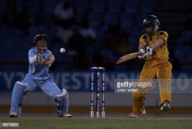 Sulakshana Naik of India looks on asJessica Cameron hits out during the ICC Womens World Cup Twenty20 semi final between Australia and India played...