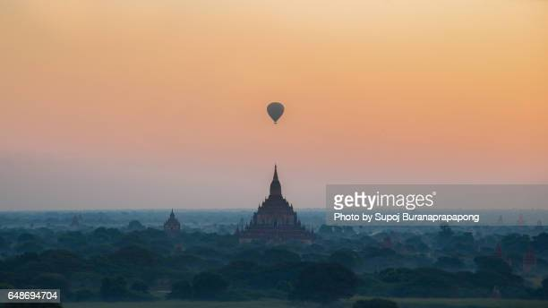 Sulamani pagoda temple with Hot air bolloon in the morining fog and sunrise before earthquake bagan , Myanmar