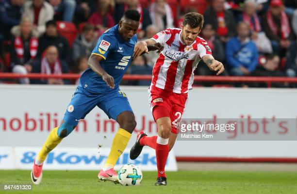 Suleiman Abdullahi of Braunschweig battles for the ball with Christopher Trimmel of Berlin during the Second Bundesliga match between 1 FC Union...