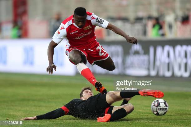 Suleiman Abdullahi of FC Union Berlin is challenged by Maximilian Thalhammer of SSV Jahn Regensburg during the Second Bundesliga match between 1. FC...