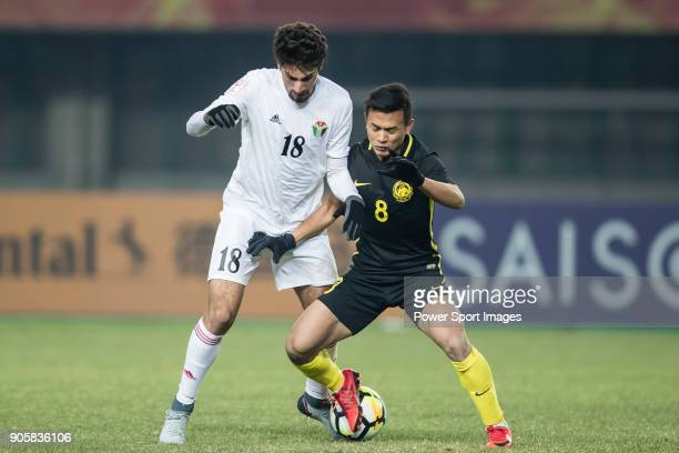 Suleiman Abu Zam'a of Jordan fights for the ball with Nor Azam Azih of Malaysia during the AFC U23 Championship China 2018 Group C match between...
