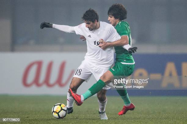 Suleiman Abu Zam'a of Jordan fights for the ball with Safaa Hadi of Iraq during the AFC U23 Championship China 2018 Group C match between Iraq and...