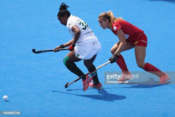 Sulette Damons of South Africa battles with Maria Lopez of Spain during the Pool C game between Spain and South Africa of the FIH Womens Hockey World...