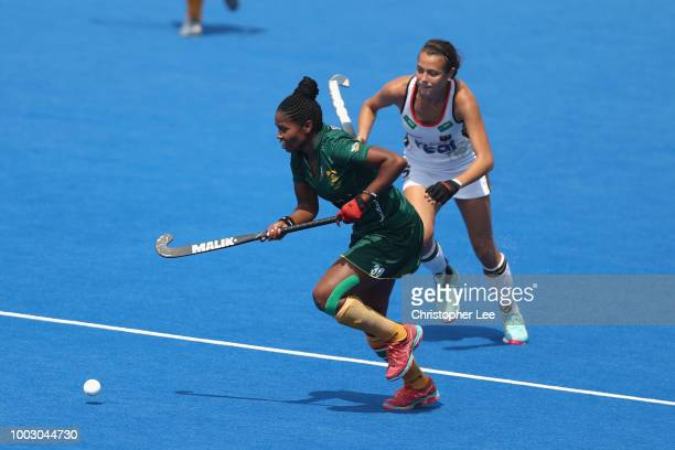 Sulette Damons of South Africa gets away from Selin Oruz of Germany during the Pool C game between Germany and South Africa of the FIH Womens Hockey...
