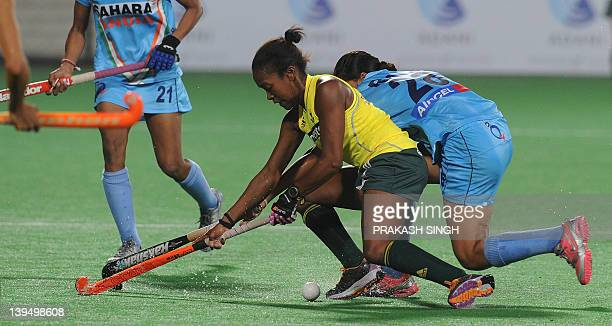 Sulette Damons of South Africa vies for the ball from Rani Rampal of India during the women's hockey match between India and South Africa of the FIH...