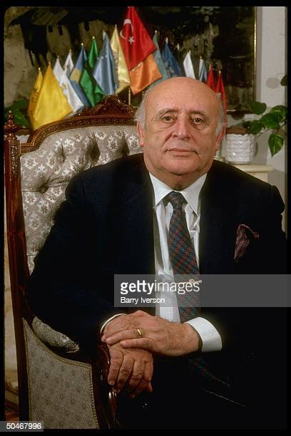 PM Suleyman Demirel during TIME interview sitting in his mini flags adorned office