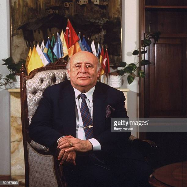 PM Suleyman Demirel during TIME interview sitting in his miniflagsadorned office