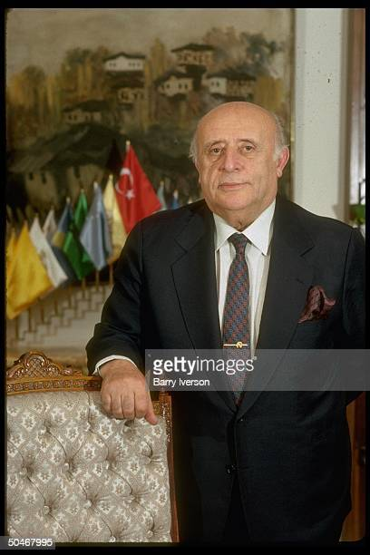 PM Suleyman Demirel during TIME interview standing in his mini flags adorned office