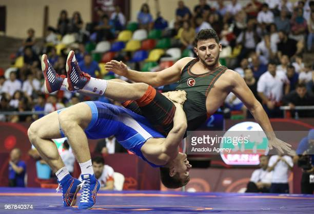 Suleyman Erbay of Turkey in action against Aleksandr Golovin of Russia during the semifinal match at the U23 Senior European Championships in...